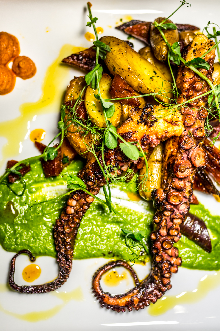 Octopus: fingerling potatoes, Spanish chorizo, charred carrots, romesco, and salsa verde / Image: Catherine Viox // Published: 9.5.19