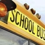 Police say school bus hit boy running across street