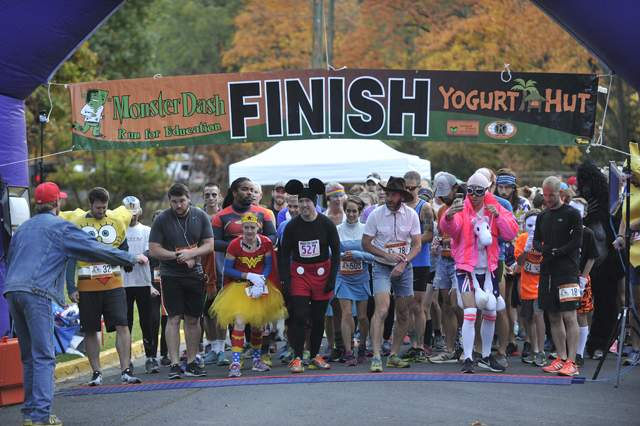 Runners participate in the Monster Dash at Lithia Park on Saturday. [Mail Tribune / Jamie Lusch] - Jamie Lusch