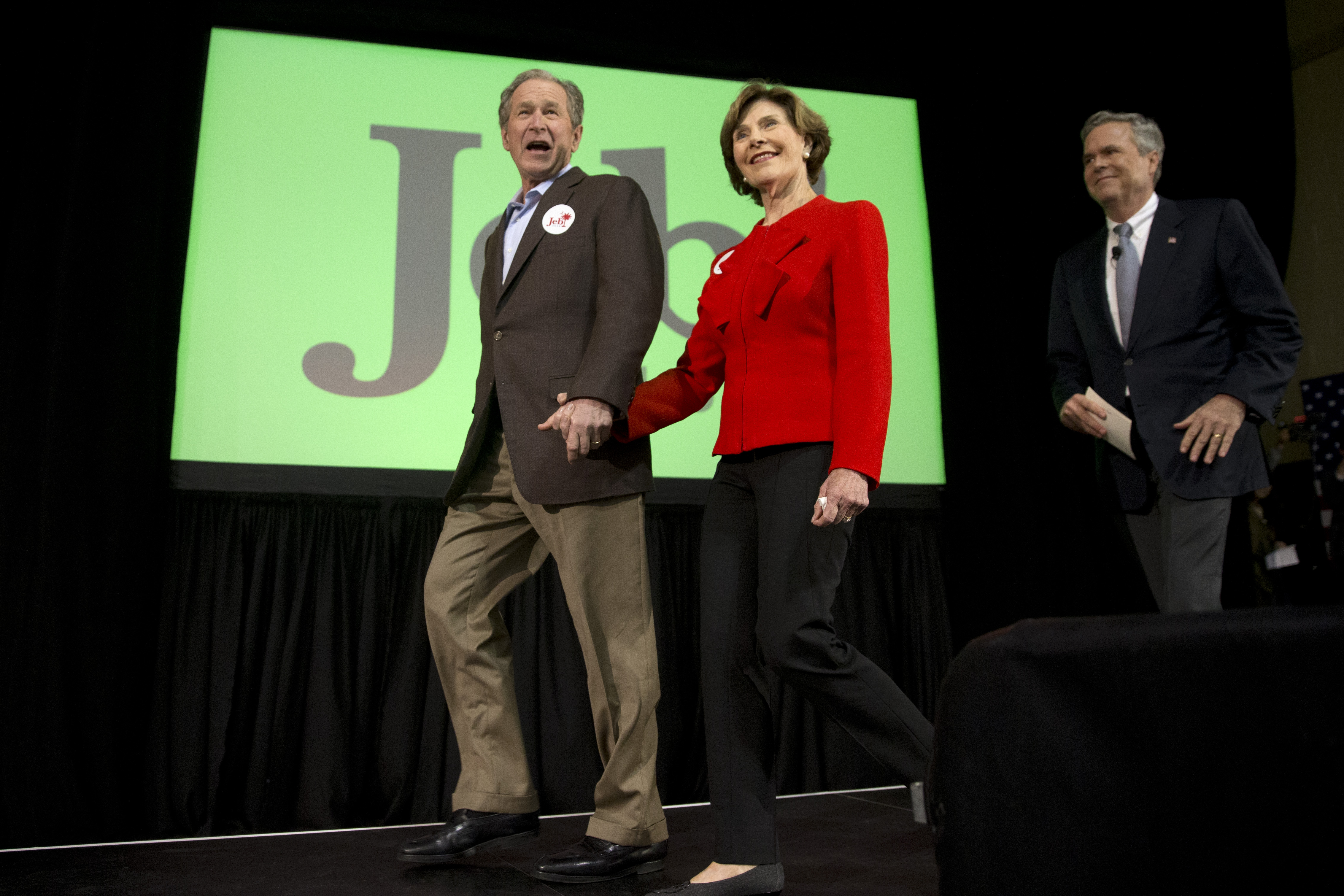Republican presidential candidate and former Florida Gov. Jeb Bush, right, accompanied by his brother former President George W. Bush, left, and George's wife Laura Bush, takes the stage during a campaign stop Monday, Feb. 15, 2016, in North Charleston, S.C. (AP Photo/Matt Rourke)