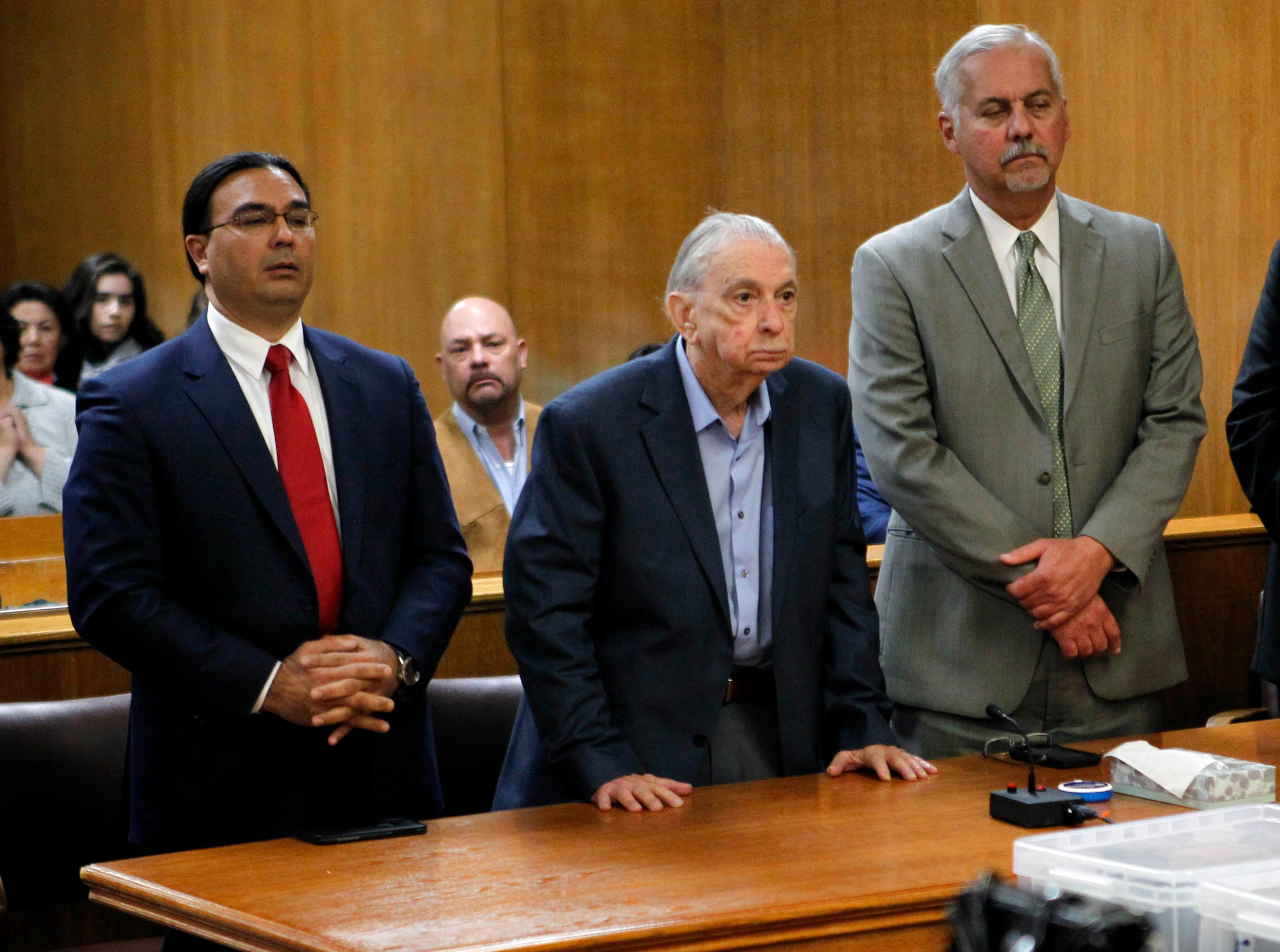 John Bernard Feit, center, listens to the announcement of a guilty verdict in his trial for the 1960 murder of Irene Garza as his lawyers, O. Rene Flores, left, and A. Ricardo Flores stand beside him in the 92nd state District Court Thursday, December 7, 2017, at the Hidalgo County Courthouse in Edinburg. (Nathan Lambrecht/The Monitor/Pool)
