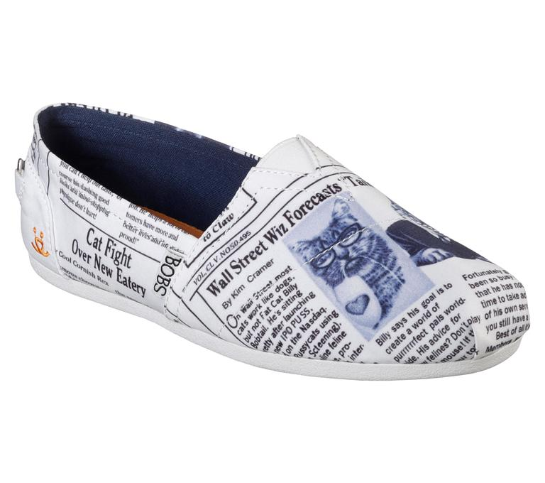 "Show off your cat pride with blue kitty cartoons against a white and black newsprint and ""BOBS for Cats"" logo detail on heel. The casual slip ons work well for walking all over the city in style. The purchase of BOBS shoes helps Skechers donate to Best Friends Animal Society, a no-kill organization for animals. Meow! (Image: Courtesy Skechers)"