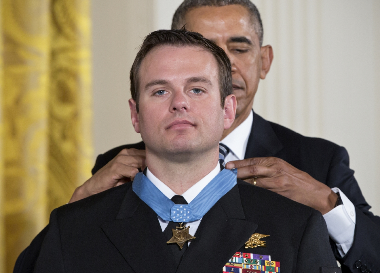 President Barack Obama presents the Medal of Honor to Senior Chief Special Warfare Operator Edward Byers during a ceremony in the East Room of the White House in Washington, Monday, February 29, 2016. Navy Senior Chief Byers is received the Medal of Honor for his courageous actions while serving as part of a team that rescued an American civilian being held hostage in Afghanistan on December 8-9, 2012. (AP Photo/J. Scott Applewhite)