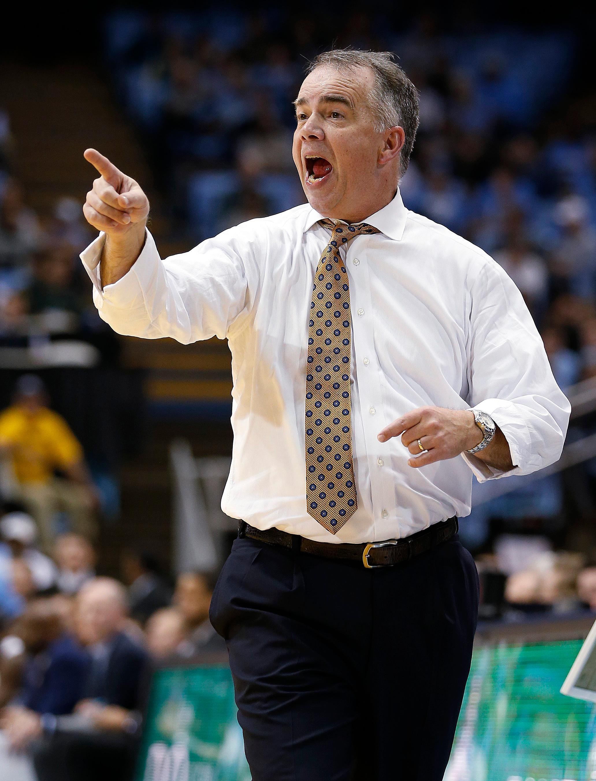 Wofford coach Mike Young gestures during the second half of the team's NCAA college basketball game against North Carolina in Chapel Hill, N.C., Wednesday, Dec. 20, 2017. Wofford upset North Carolina, 79-75. (AP Photo/Ellen Ozier)