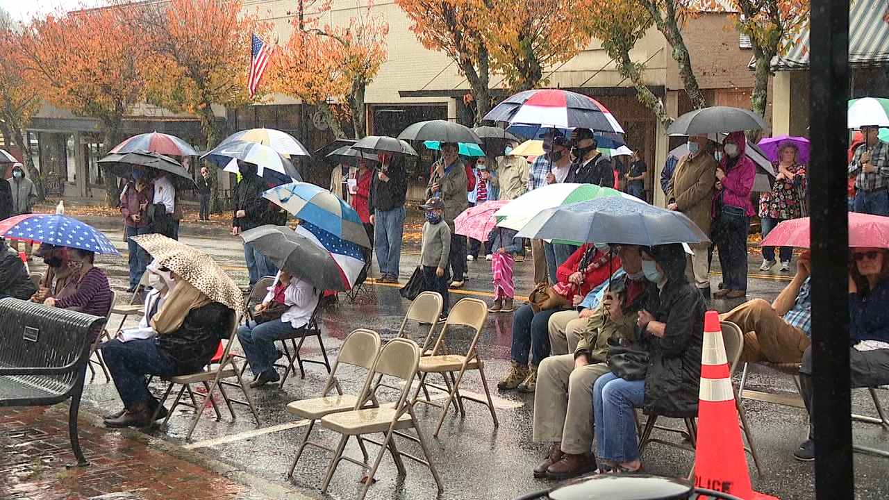 Nov. 11, 2020 - Transylvania County residents braved heavy downpours Wednesday morning to honor those who served this Veterans Day by attending a ceremony in downtown Brevard. (Photo credit: WLOS Staff)
