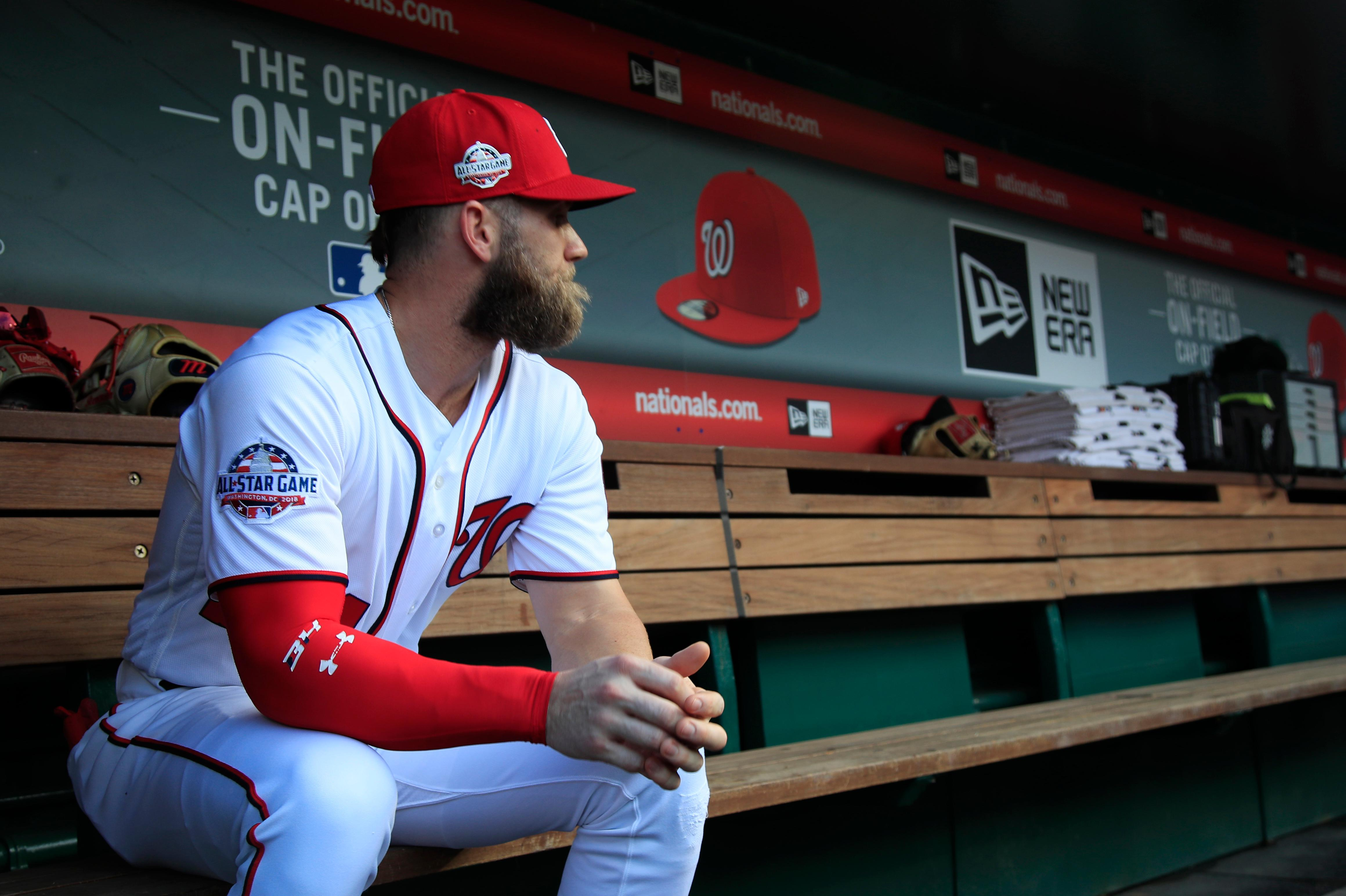 Washington Nationals Bryce Harper, looks at the baseball field from their dug out before the start of the Nationals last home game of the season against the Miami Marlins in Washington, Wednesday, Sept. 26, 2018. (AP Photo/Manuel Balce Ceneta)
