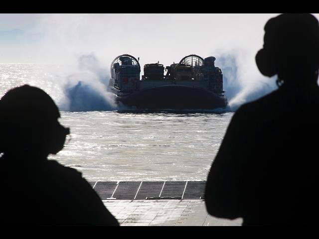 U.S. Marines and sailors aboard the amphibious assault ship USS Makin Island perform well deck operations with landing craft air cushion vehicles in the Pacific Ocean, April 9, 2014.