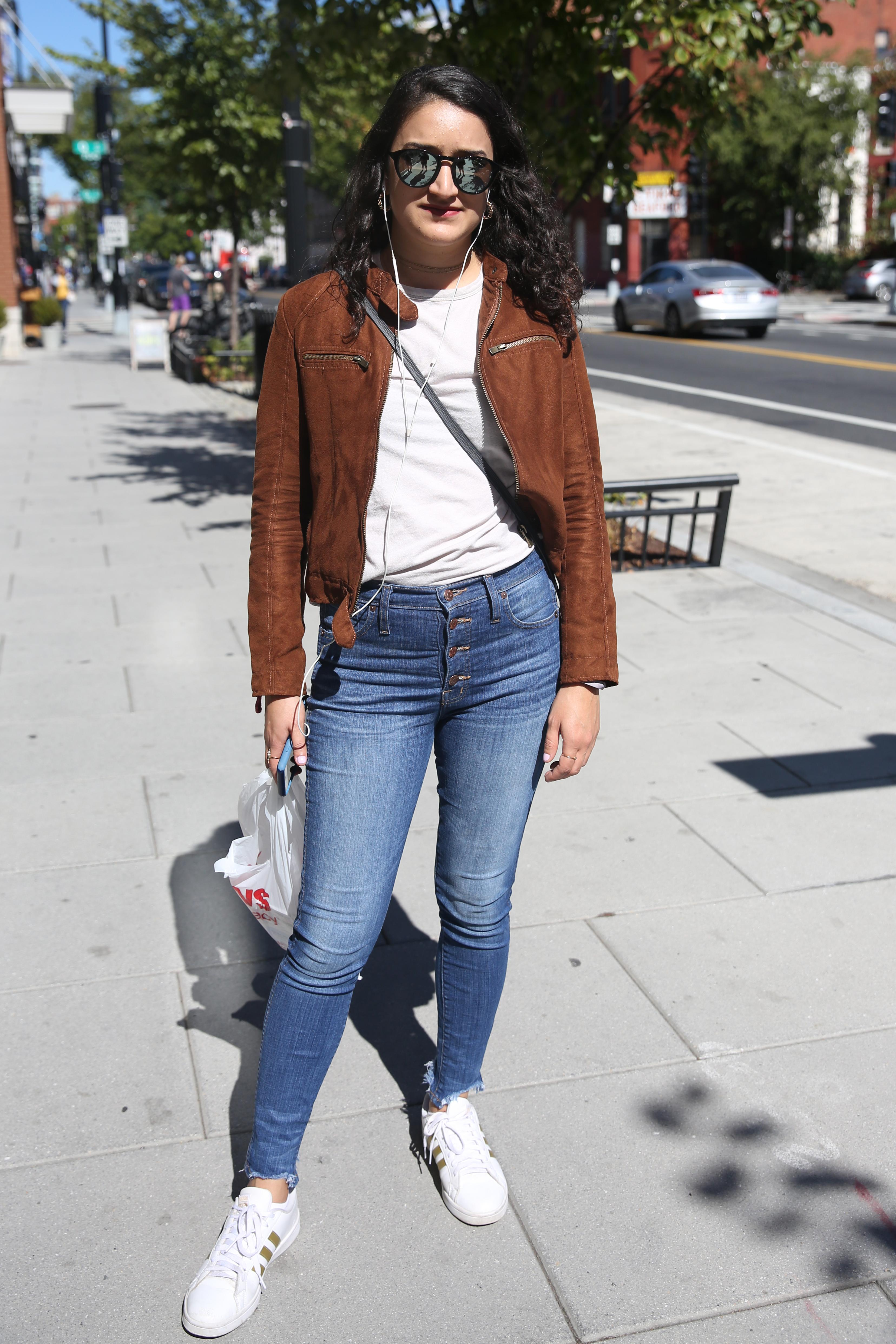 Lori Ismail's high-waisted jeans and brown moto jacket are a modern take on the 70s. The dainty accessories pull the whole look together. (Amanda Andrade-Rhoades/DC Refined)