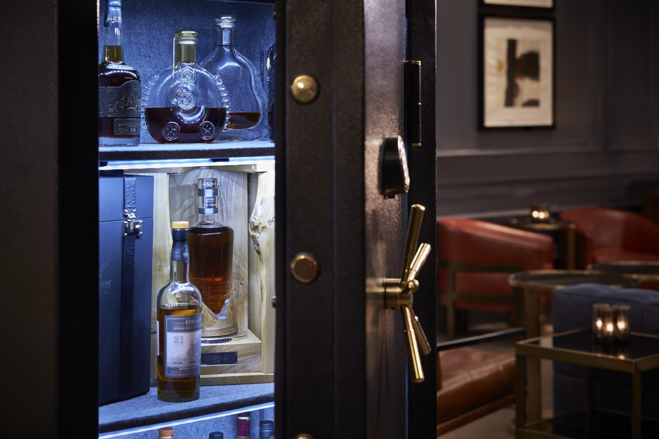 D.C.'s Ritz Carlton Hotel just unveiled The Vault, a combination safe measuring six feet and four feet wide that houses its most precious bottles of spirits--including one über rare bottle just procured, the Bowmore 1961 50 Year Old Single Malt Scotch Whisky from Islay, Scotland. (Image: Greg Powers)