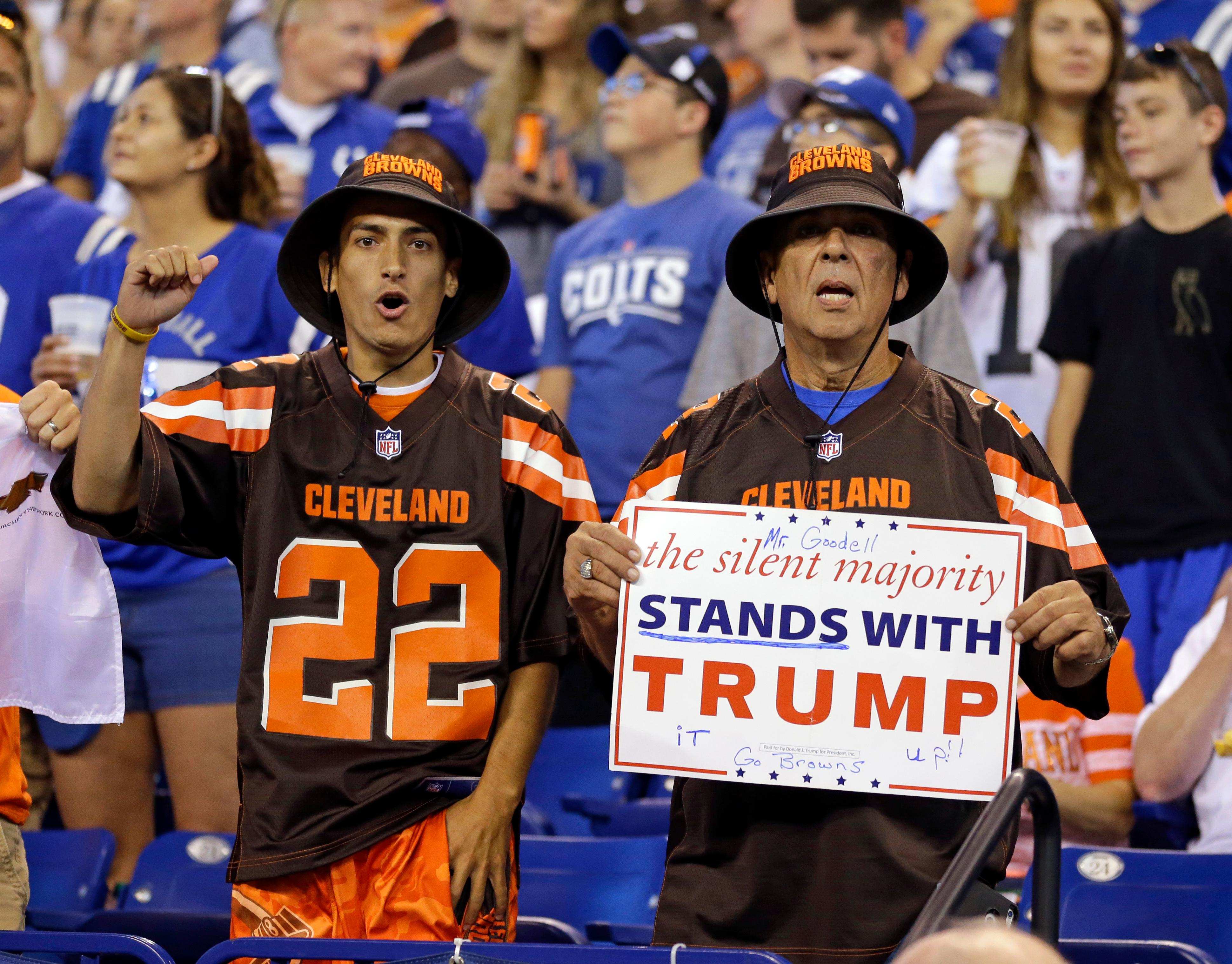 Cleveland Browns fans hold a sign following the national anthem before an NFL football game between the Indianapolis Colts and the Cleveland Browns in Indianapolis, Sunday, Sept. 24, 2017. (AP Photo/Michael Conroy)