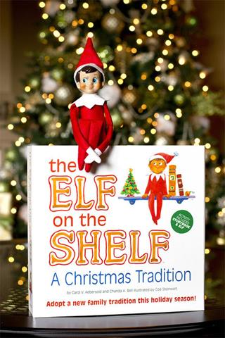 "This file photo provided by CCA&B, LLC, shows ""The Elf on the Shelf: A Christmas Tradition"". It involves a picture book and a stuffed, felt elf that serves as a scout for Santa and has to be moved stealthily every night."