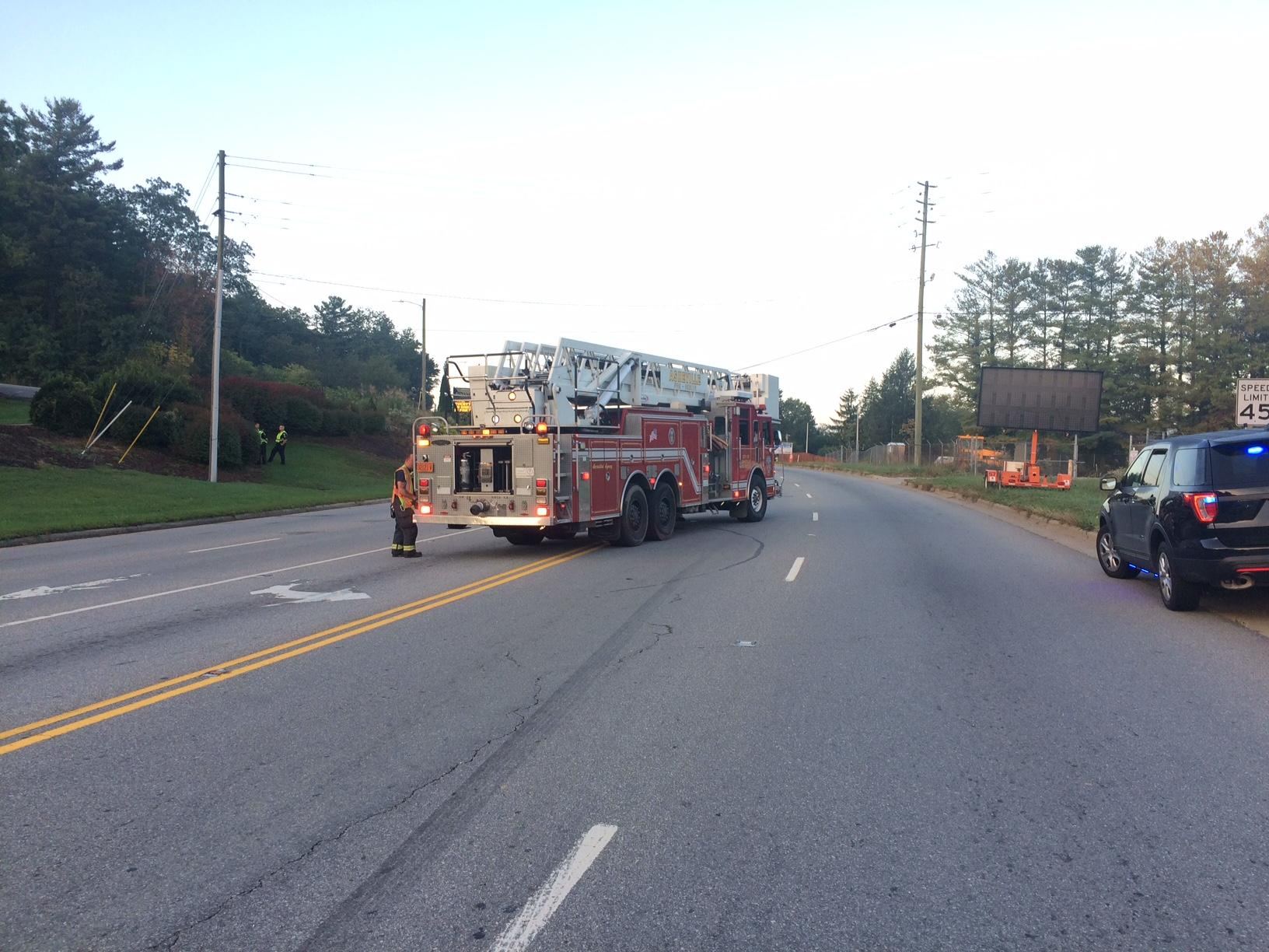 The Asheville Police Department confirms a crash on Airport Road Thursday morning is fatal. (Photo credit: WLOS Staff)