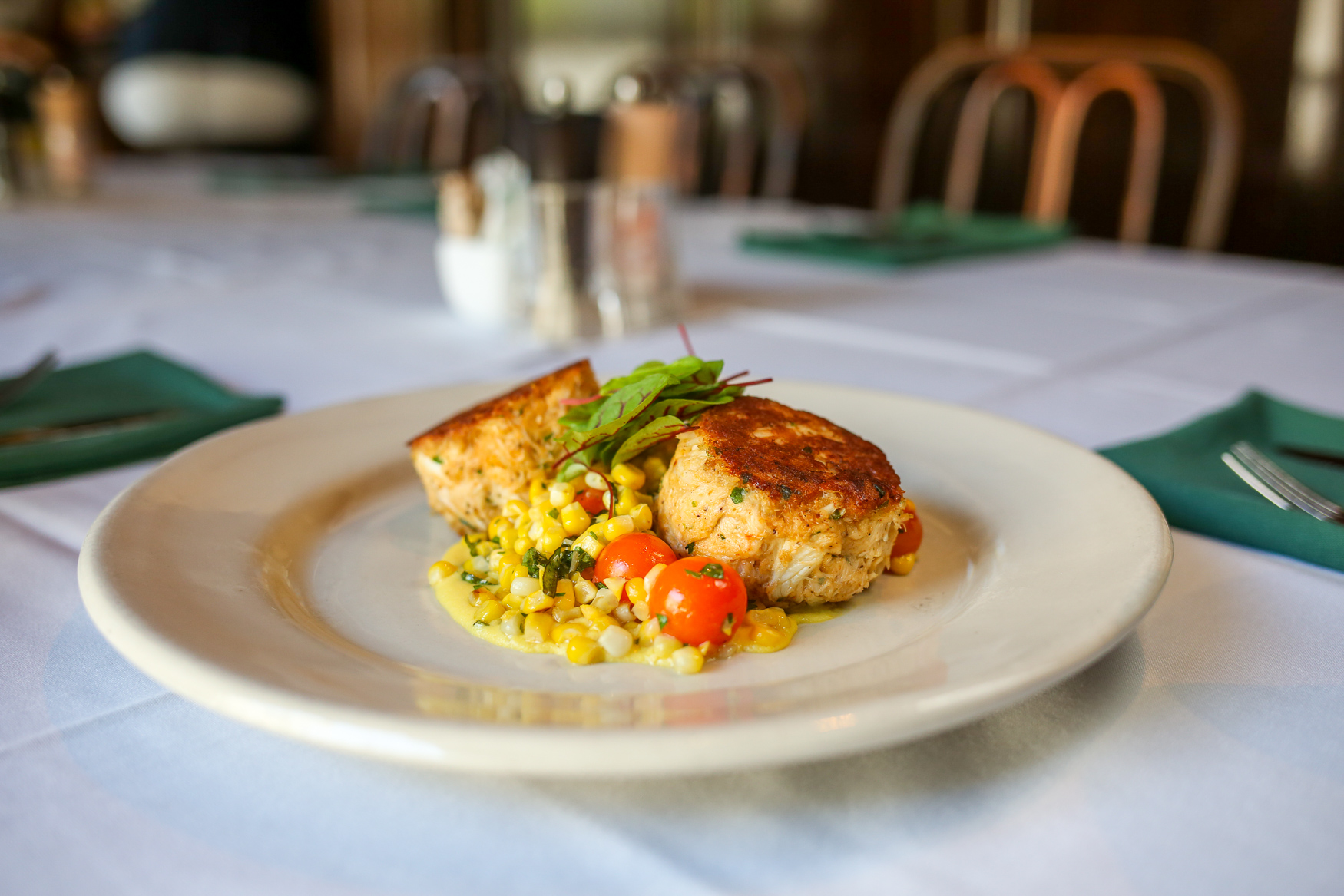 The Jumbo Lump Crab Cake, served with Chesapeake corn and tomatoes and roasted fingerling potatoes (Amanda Andrade-Rhoades/DC Refined)