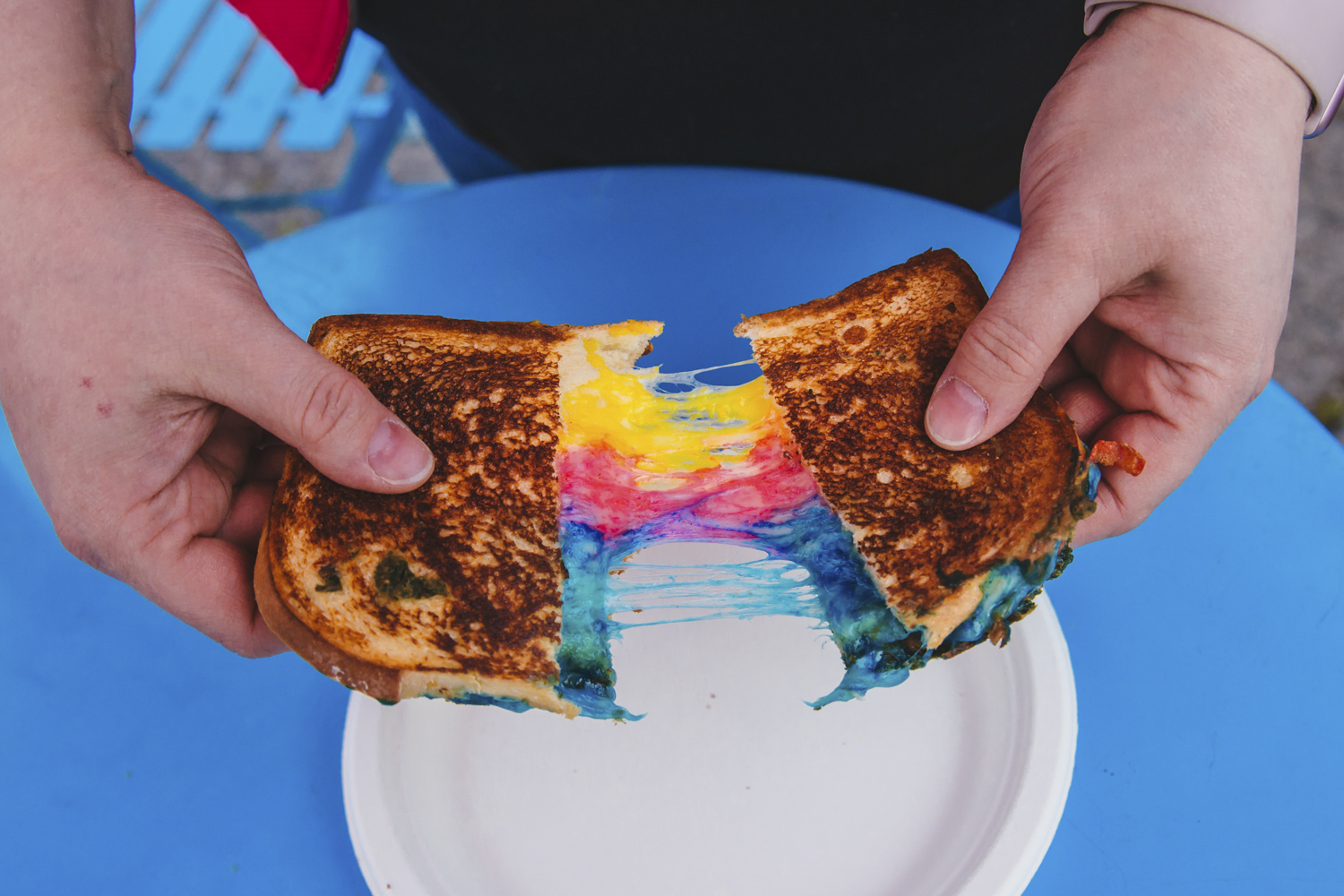 <p>&quot;Unicorn Grilled Cheese&quot; from Island Grilled Cheese.  A rainbow of Darigold Cheese between two perfectly toasted slices of bread. Seattle's annual Grilled Cheese Grand Prix event kicked off this weekend, properly celebrating April as National Grilled Cheese Month. We went, obviously (for work....) and here were the juiciest sammies on the block we could find. The good news? Pretty much all of these come from brick and mortar stores you can find any time in the city - not just April, and not just t the Grand Prix. (Image: Sunita Martini / Seattle Refined)</p>