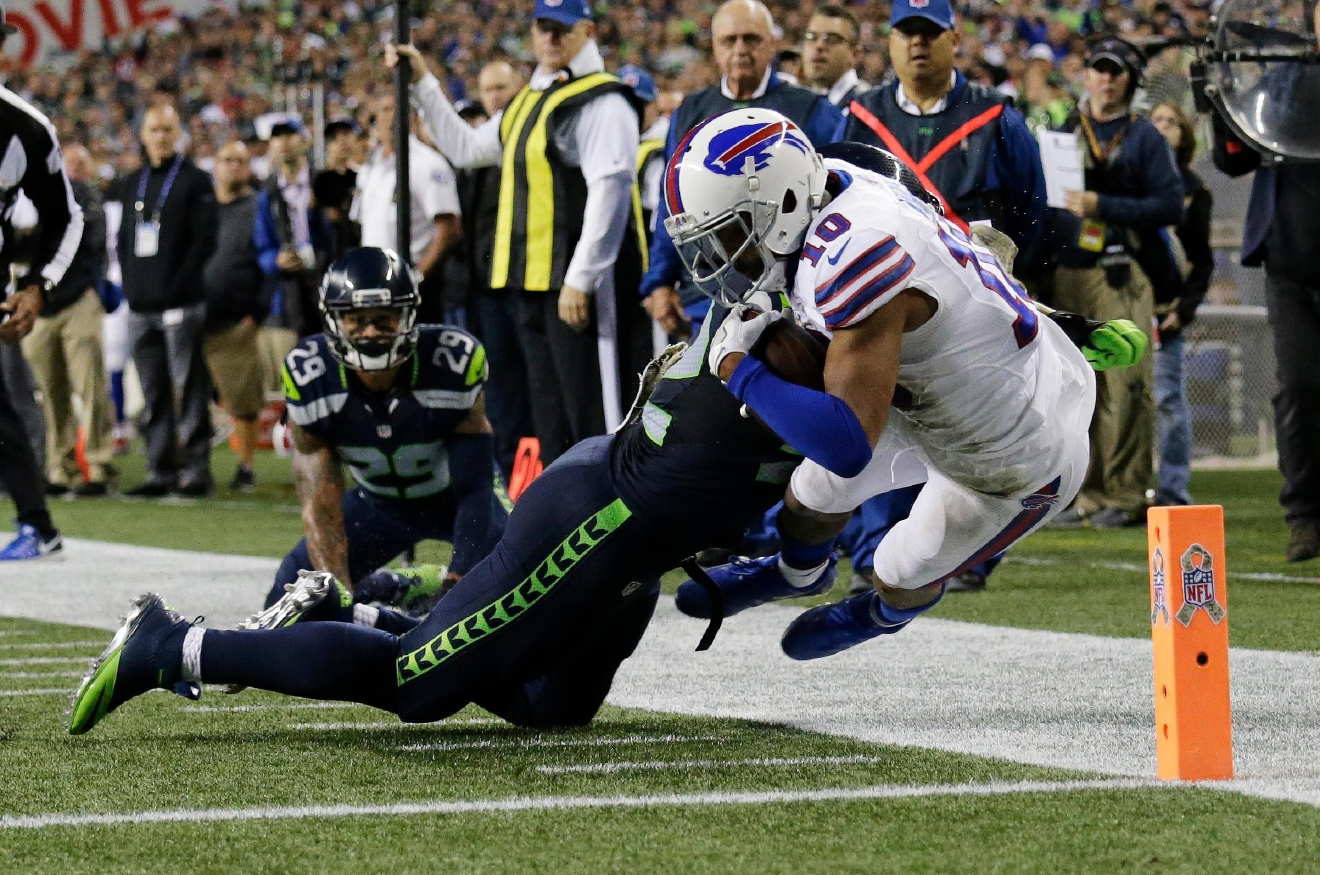 Buffalo Bills wide receiver Robert Woods (10) is pushed out-of-bounds at the goal line by Seattle Seahawks outside linebacker Brock Coyle in the second half of an NFL football game, Monday, Nov. 7, 2016, in Seattle. (AP Photo/John Froschauer)