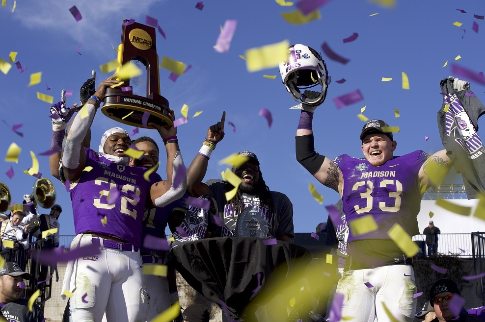 JMU 28, YOUNGSTOWN STATE 14: The Dukes (14-1) took a 21-0 lead and cruised to their 12th consecutive victory and second national title. LB Gage Steele (33) led a dominant defensive performance and Khalid Abdullah (32) capped a record season with 101 yards rushing and 2 TDs. The Dukes registered 5 sacks and 2 turnover while holding Youngstown State (12-4) to 21 rushing yards. The Penguns had been averaging 257.5. Abdullah, ASN's FCS Player of the Year, set JMU's single-season records with 1,809 yards and 150 points.  (Photo by Jamie Schwaberow/NCAA Photos via Getty Images)