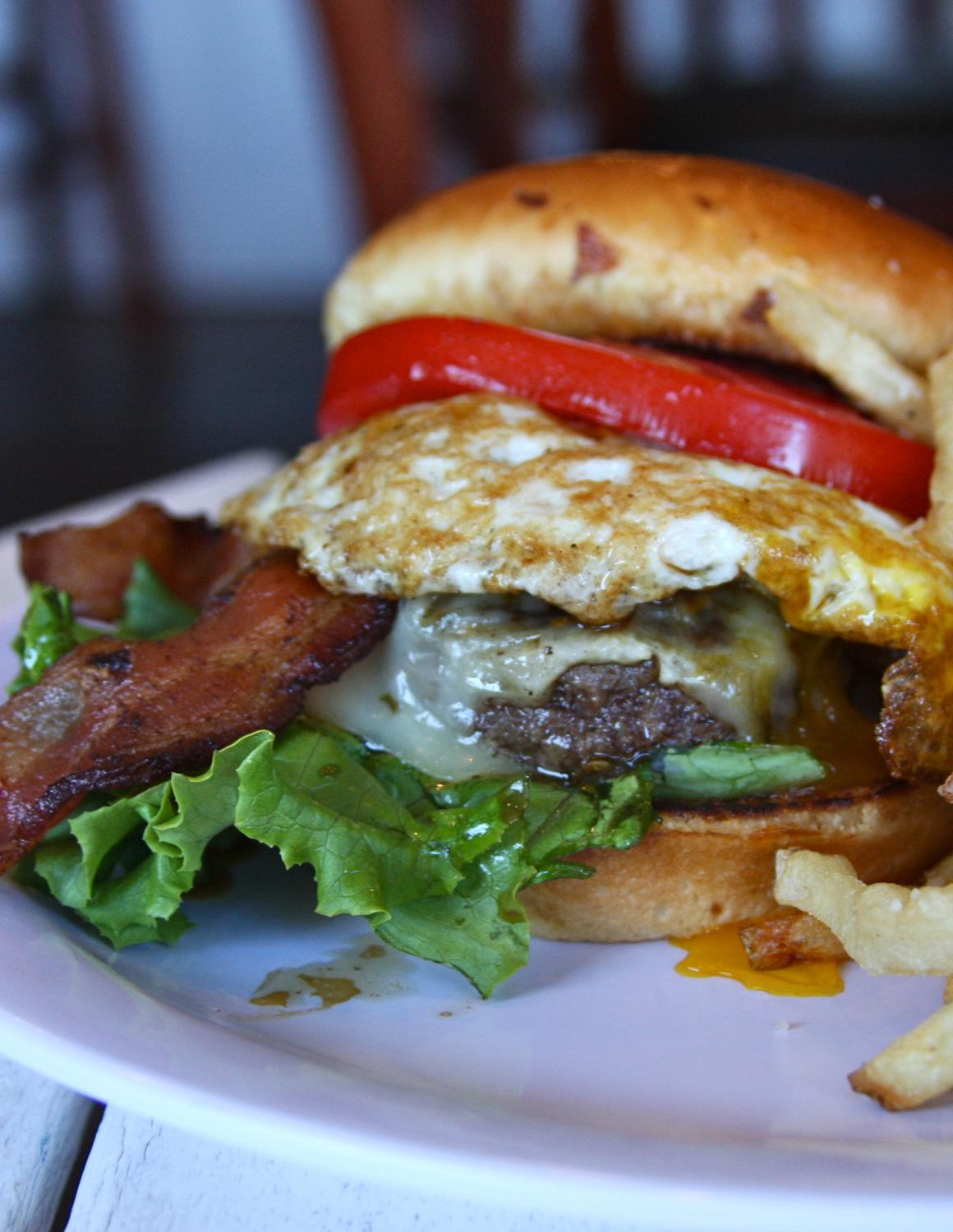 Bones' Farm Burger: fried organic egg, applewood smoked bacon, pepper jack cheese / Image: Molly Paz