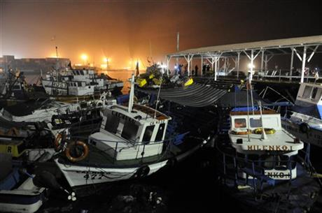 Fishing boats washed ashore by a small tsunami sit in Caleta Riquelme, adjacent to the port, in the northern town of Iquique, Chile, after magnitude 8.2 earthqauke struck the northen coast of Chile, Wednesday, April 2, 2014.