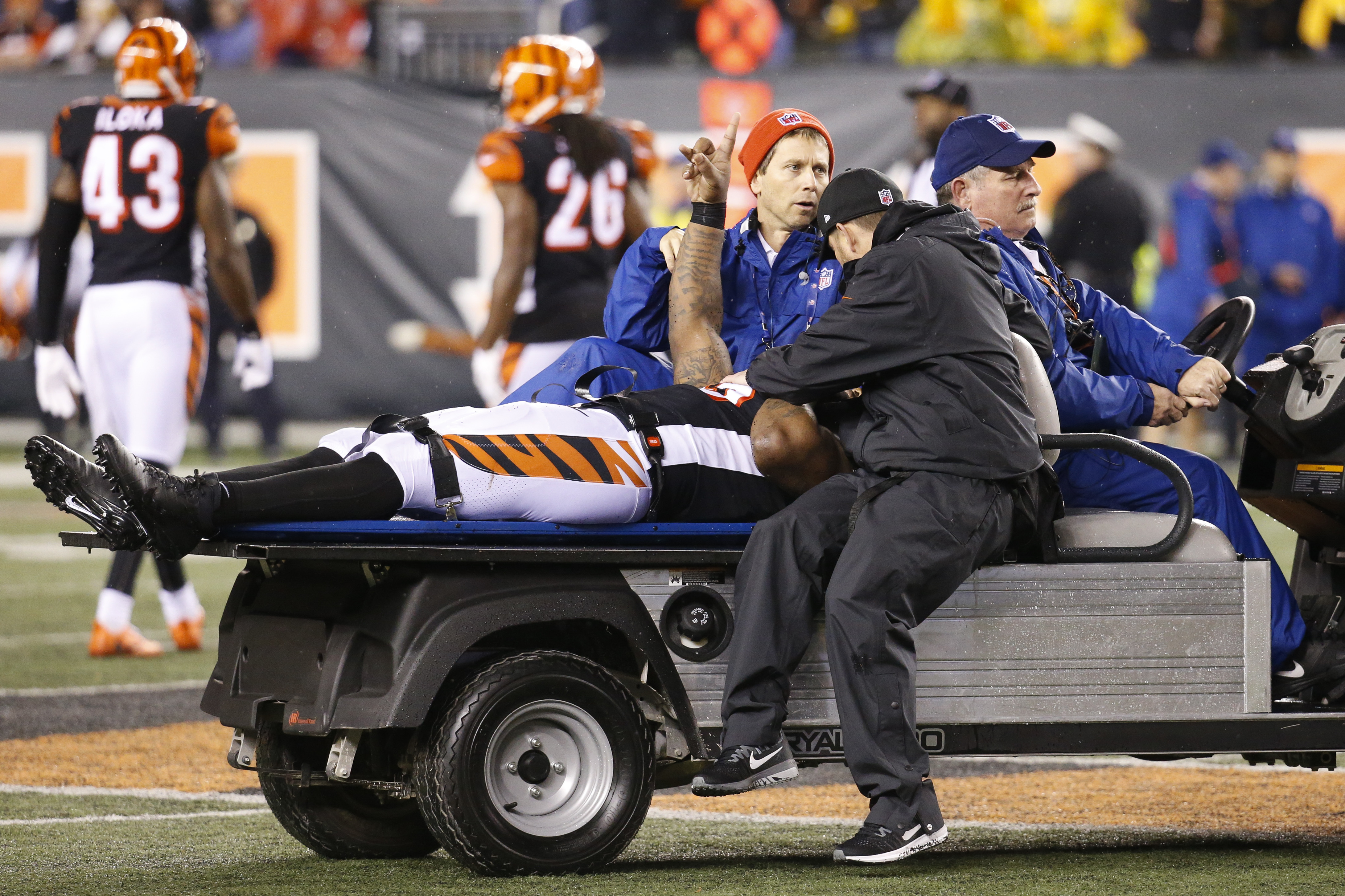 Cincinnati Bengals outside linebacker Vontaze Burfict gestures as he is carted off the field after an apparent injury in the second half of an NFL football game against the Pittsburgh Steelers, Monday, Dec. 4, 2017, in Cincinnati. (AP Photo/Frank Victores)