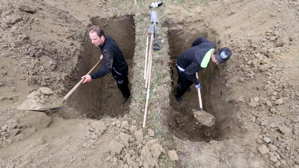 Speedy shovels shine in Slovakia's grave-digging contest ...