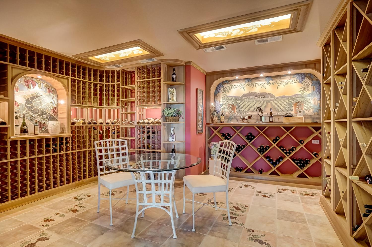 2,000 bottle capacity climate-controlled wine cellar with a tasting room that features handprinted wine-themed murals / Image: Wow Video Tours // Published: 6.8.18