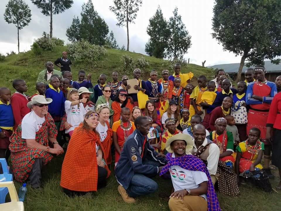 Pay it Forward: Humanitarian group is showing the power of 100 people to do good (Photo courtesy 100 Humanitarians International)