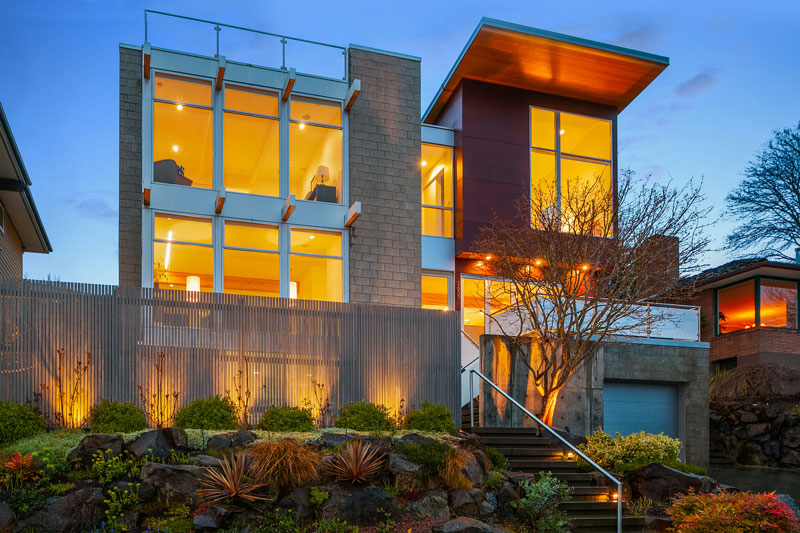 "<p>This week we're previewing houses from{&nbsp;}<a  href=""http://mads.media/2019-seattle-modern-home-tour/"" target=""_blank"" title=""http://mads.media/2019-seattle-modern-home-tour/"">Seattle's 2019 Modern Home Tour</a>, happening Saturday, April 27. Our final home is a 4 bed/4 bath in Magnolia, and is described as having the winning combination of{&nbsp;}stylish design, impeccable craftsmanship, fabulous floor plan, and views! Amenities include front & back patios, a sport court, turf yard with putting green, huge rooftop deck and hot tub. Next Century Modern. Architect: Stan Hanson; Landscaping & Interior: Heidi and Rick Ward. (Image: Next Century Modern / 360 modern)</p>"