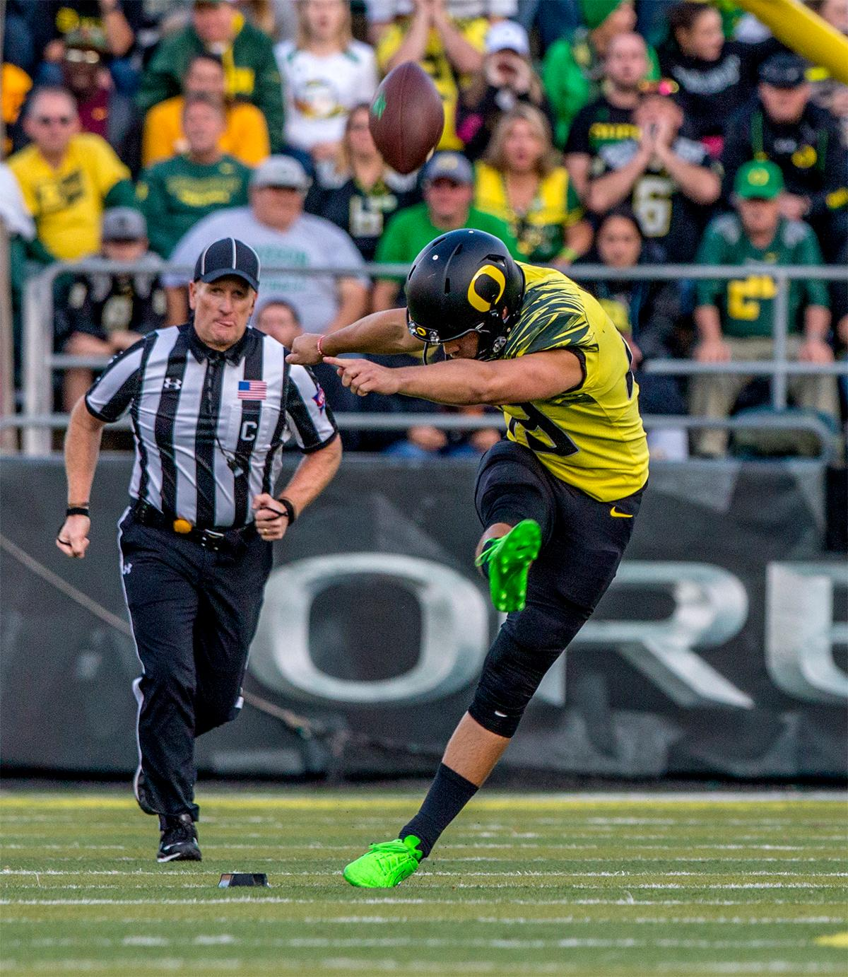 The Duck's Matt Wogan (#49) performs the kick off. The Oregon Ducks broke their losing streak by defeating the ASU Sun Devils on Saturday 54-35. Photo by August Frank, Oregon News Lab