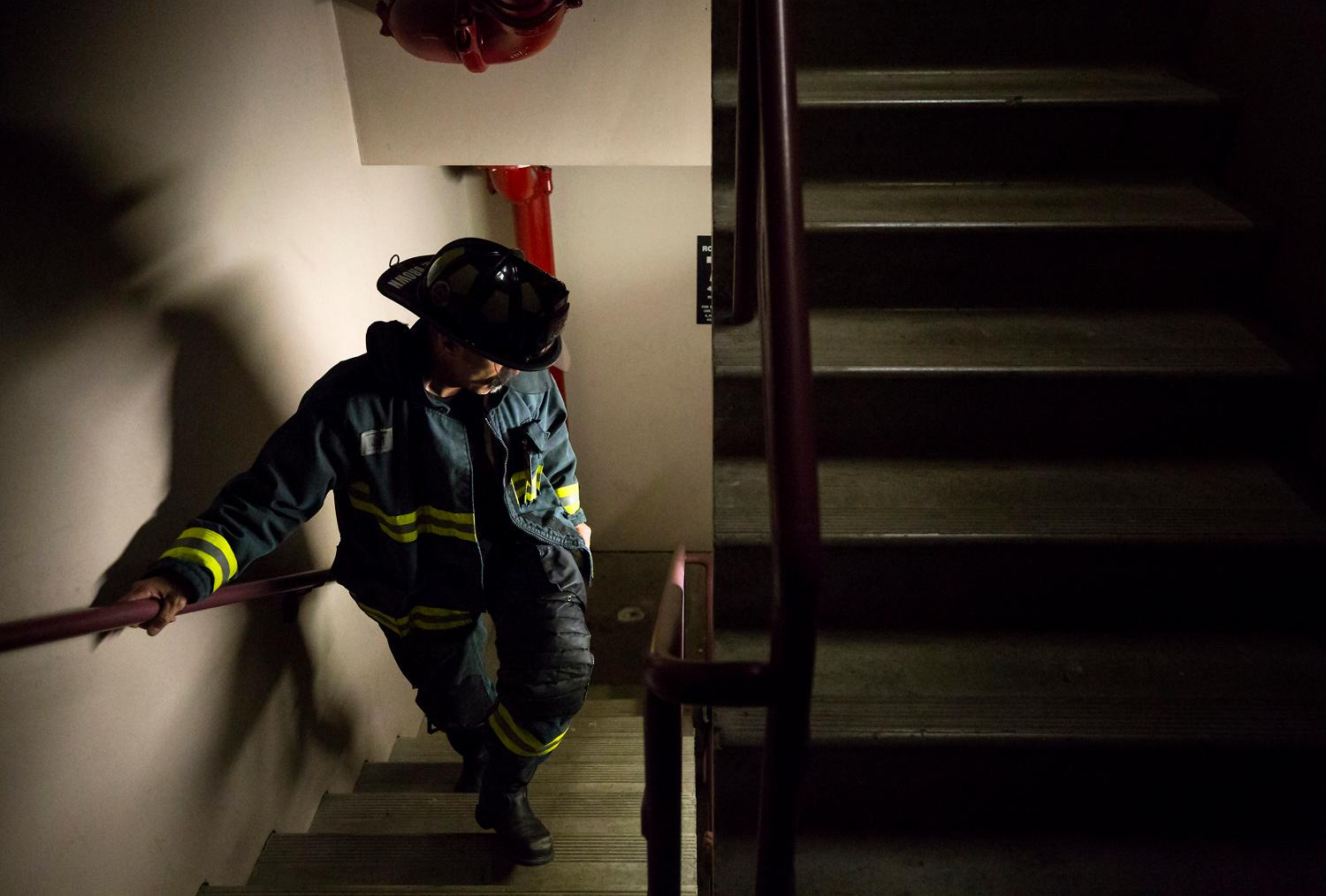 Rich Brown, lead ambassador and firefighter from Boise, Idaho, does a training climb for the Scott Firefight Stairclimb that benefits the Leukemia & Lymphoma Society on Friday, March 9, 2018. 2,000 firefighters will climb the 69 floors (1,356 stairs!) on Sunday to the Sky View Observatory of the Columbia Tower. (To donate to this cause, please visit www.firefighterstairclimb.org. (Sy Bean / Seattle Refined)