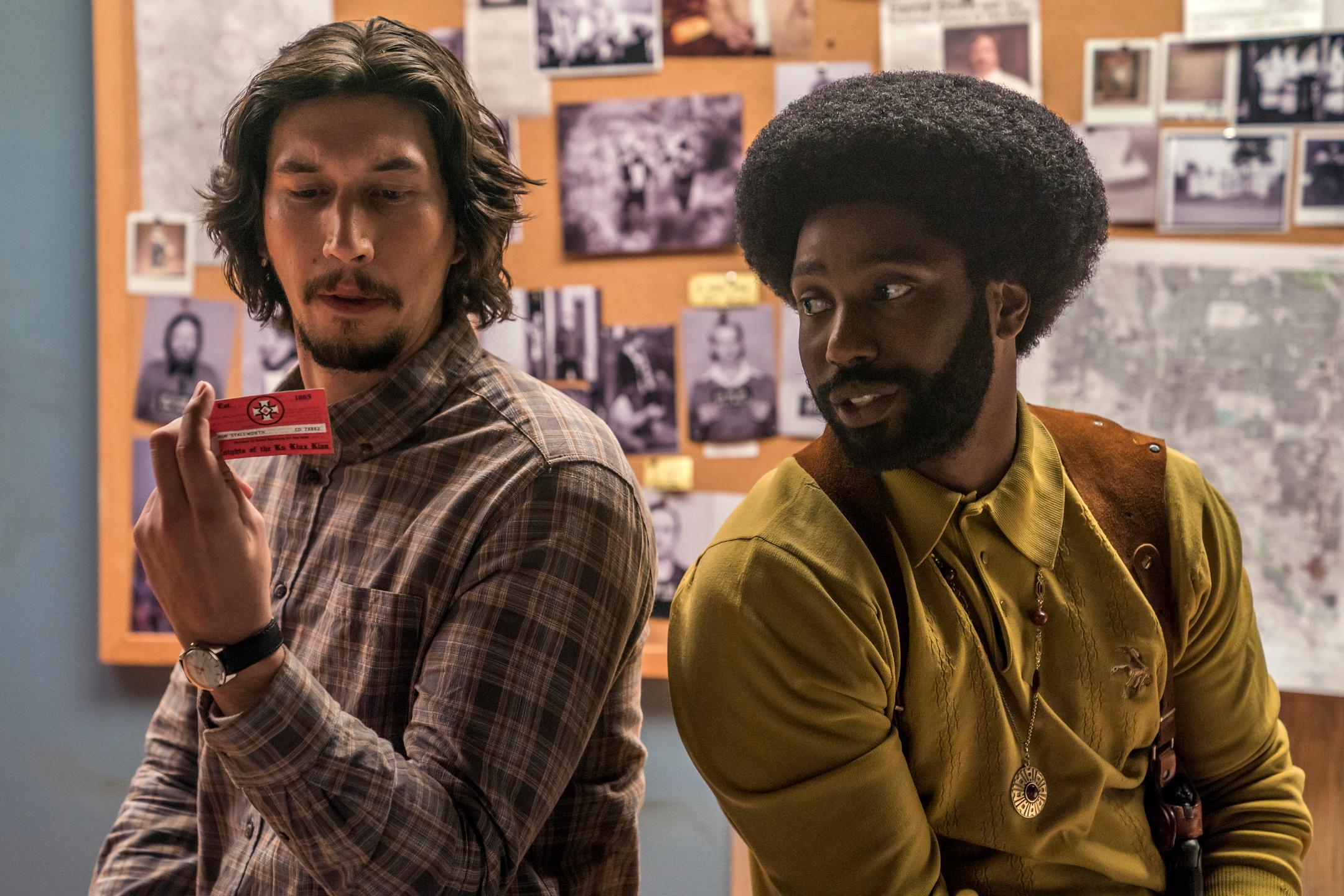 "This image released by Focus Features shows Adam Driver, left, and John David Washington in a scene from ""BlacKkKlansman."" (David Lee/Focus Features via AP)"