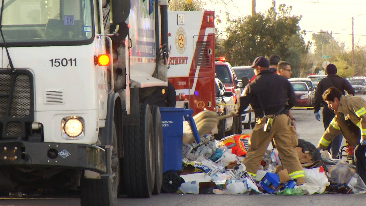 Trash thrown out from dump truck in order to rescue man hiding inside blue recycling trash bin on Tuesday, Dec. 26, 2017. (KFOX14/CBS4)