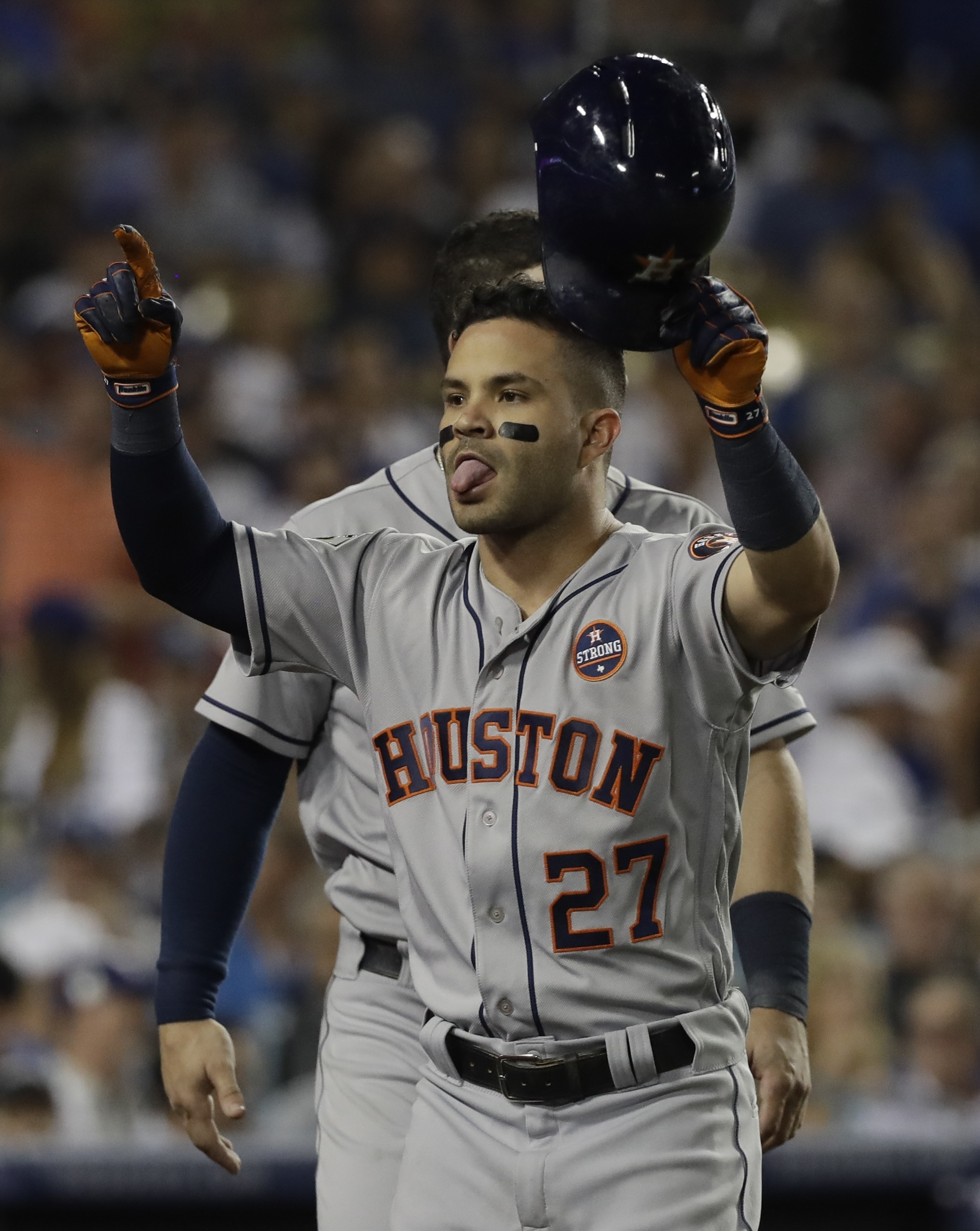 Houston Astros' Jose Altuve reacts after hitting a home run during the 10th inning of Game 2 of baseball's World Series against the Los Angeles Dodgers Wednesday, Oct. 25, 2017, in Los Angeles. (AP Photo/David J. Phillip)
