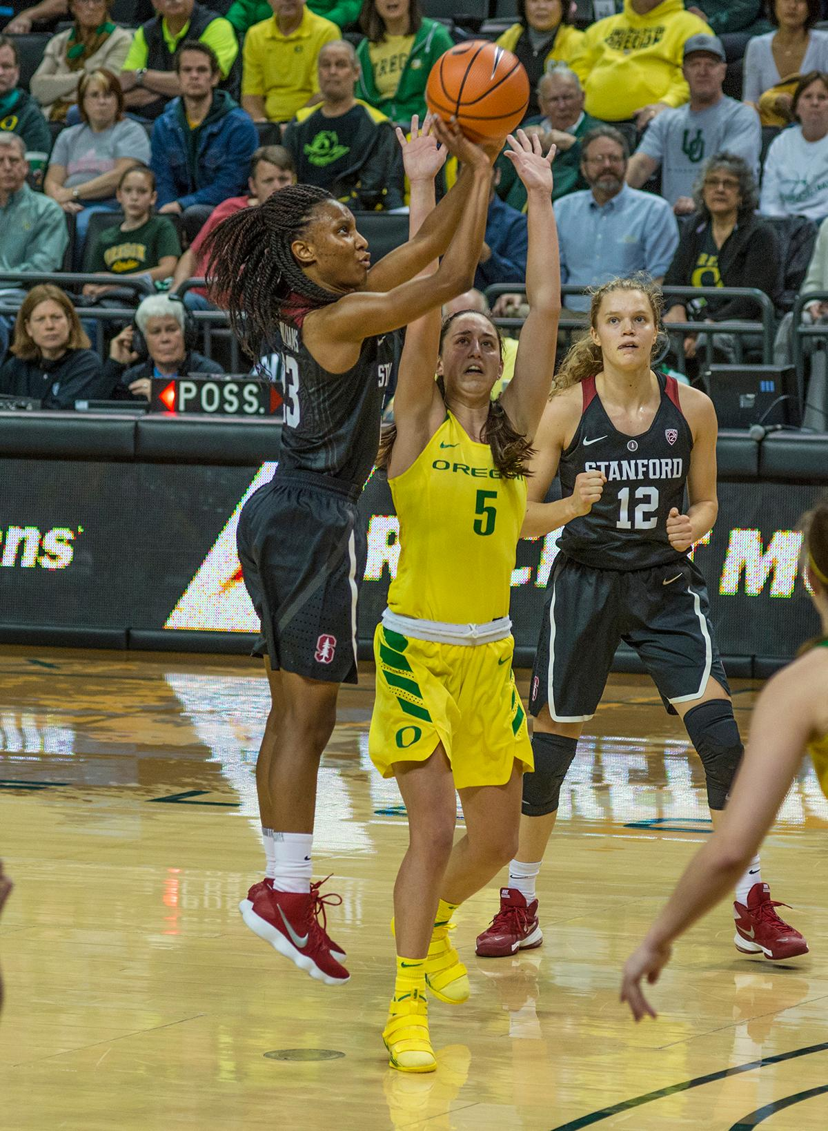 Stanford Cardinal Kiana Williams (#23) gets past Oregon Ducks Maite Cazorla (#5) for two points. The Stanford Cardinal defeated the Oregon Ducks 78-65 on Sunday afternoon at Matthew Knight Arena. Stanford is now 10-2 in conference play and with this loss the Ducks drop to 10-2. Leading the Stanford Cardinal was Brittany McPhee with 33 points, Alanna Smith with 14 points, and Kiana Williams with 14 points. For the Ducks Sabrina Ionescu led with 22 points, Ruthy Hebard added 16 points, and Satou Sabally put in 14 points. Photo by Dan Morrison, Oregon News Lab