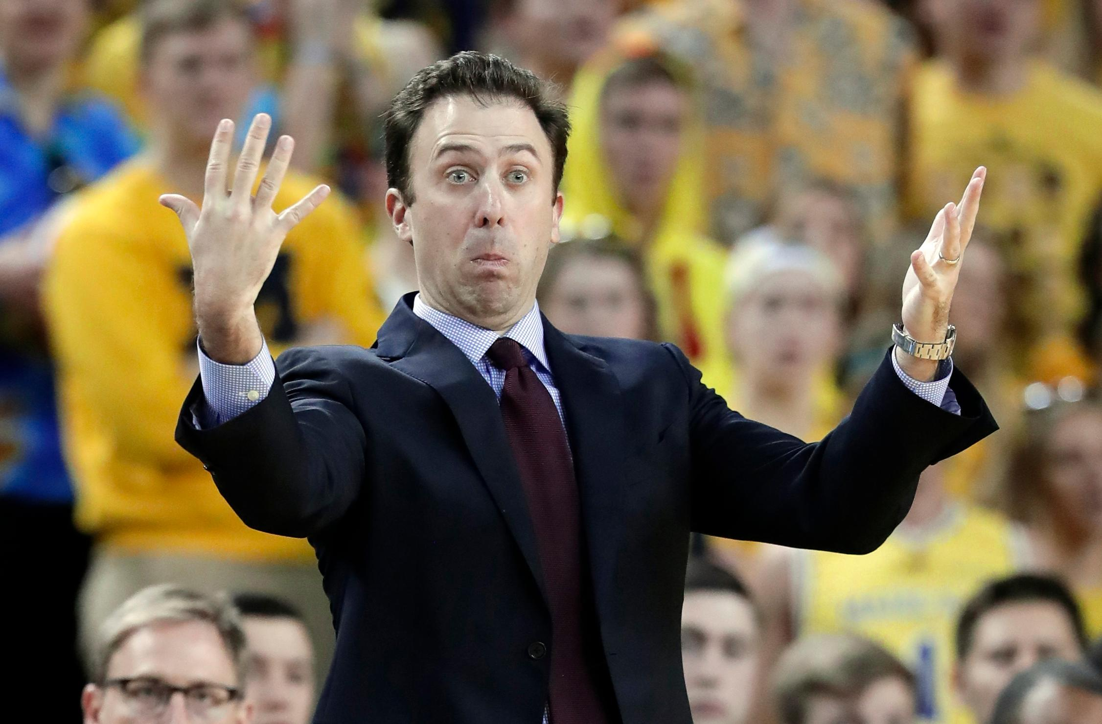 Minnesota head coach Richard Pitino gestures during the first half of an NCAA college basketball game against Michigan, Saturday, Feb. 3,2018, in Ann Arbor, Mich. (AP Photo/Carlos Osorio)