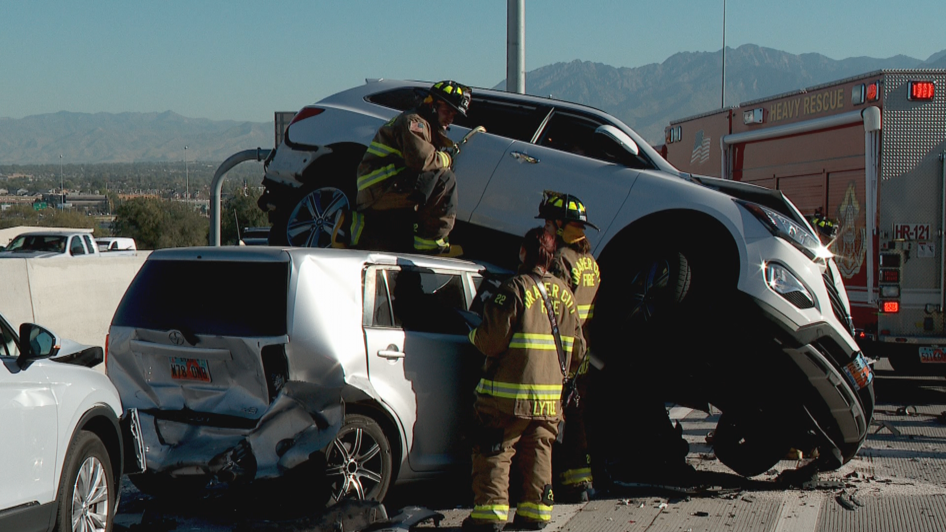 Vehicle lands on top of another during crash on I-15 in Draper. (Photo: Morgan Saxton /{ } KUTV)