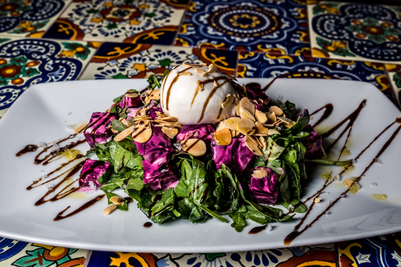 Beet Salad: roasted beets, burrata cheese, arugula, mint yogurt, toasted almonds, and an orange vinaigrette / Image: Catherine Viox // Published: 4.21.20