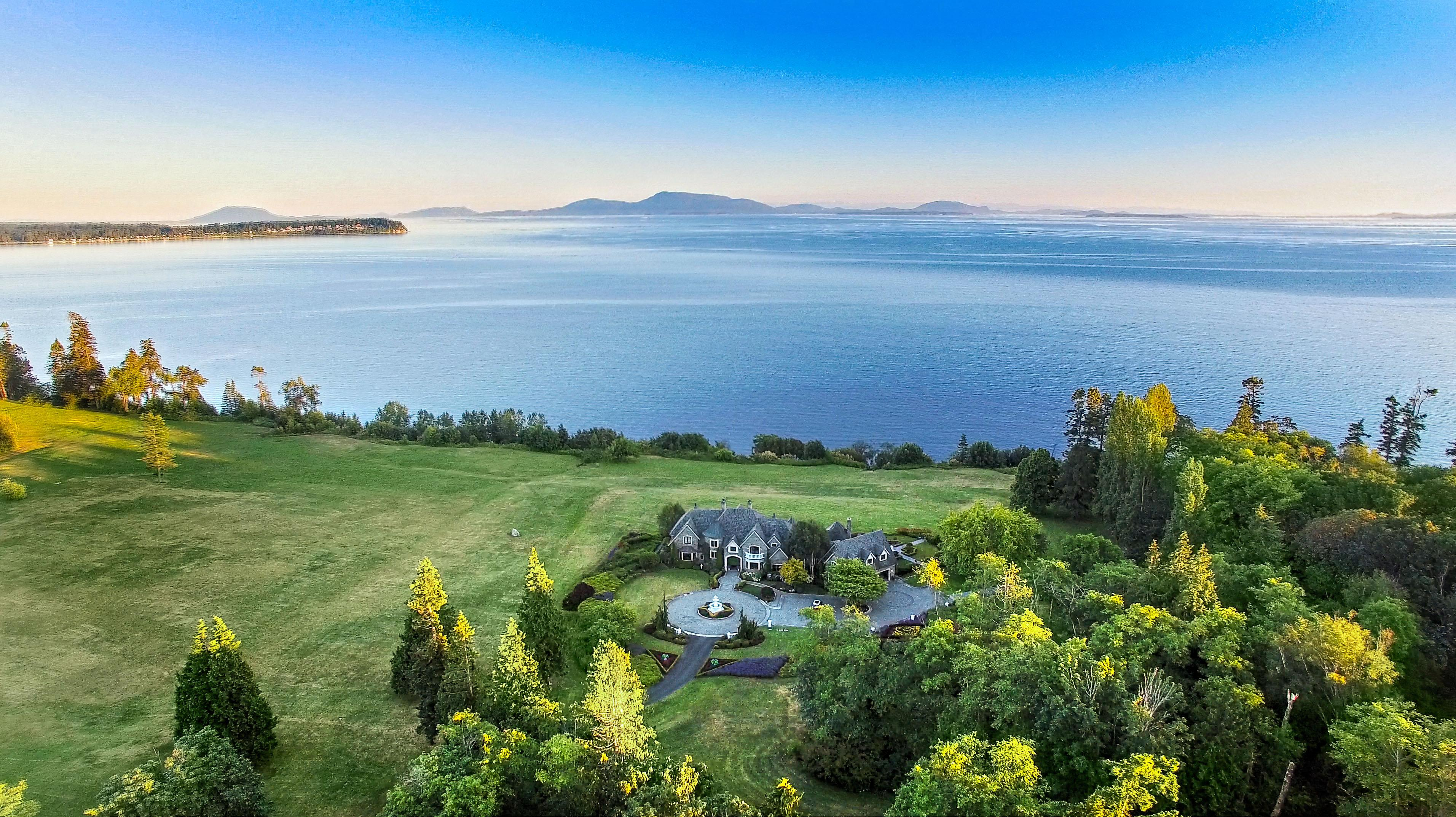 This 12,000-square-foot home on the Strait of Georgia is magnificent, but those who appreciate Washington's natural beauty might well find the property surrounding it even more stupendous.