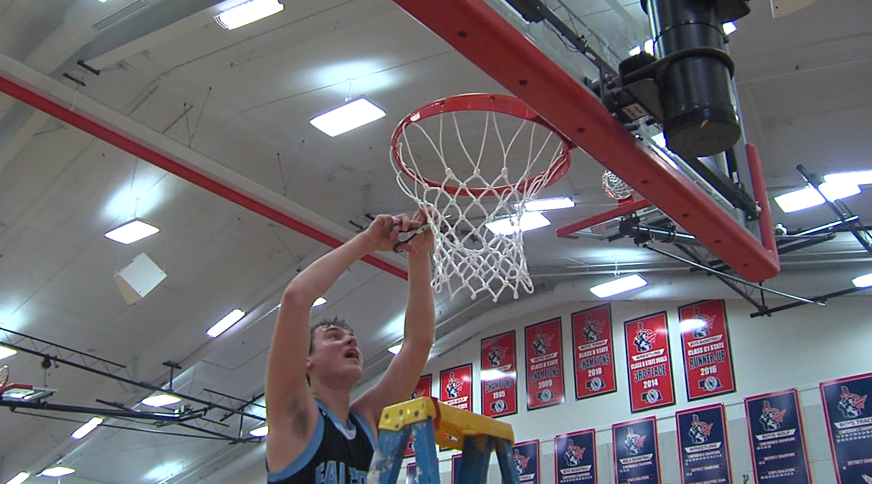 Wilcox-Hildreth cuts down the nets at Adams Central High School after their win.{&amp;nbsp;}<p></p>