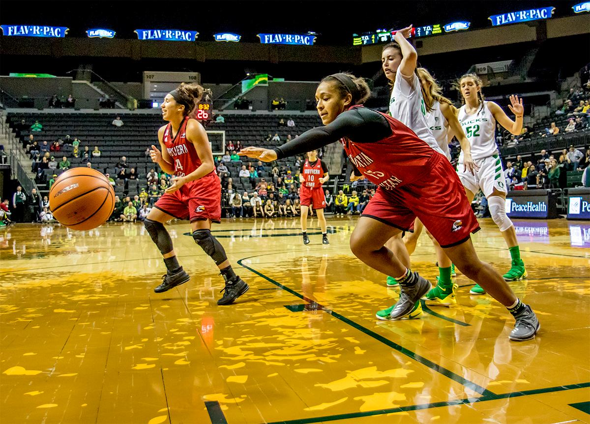 The Thunderbird's Kiana Johnson (#15) runs after a loose ball. The University of Oregon Ducks women basketball team defeated the Southern Utah Thunderbirds 98-38 in Matthew Knight Arena Saturday afternoon. The Ducks had four players in double-digits: Ruthy Hebard with 13; Mallory McGwire with 10; Lexi Bando with 17 which included four three-pointers; and Sabrina Ionescu with 16 points. The Ducks overwhelmed the Thunderbirds, shooting 50% in field goals to South Utah's 26.8%, 53.8% in three-pointers to 12.5%, and 85.7% in free throws to 50%. The Ducks, with an overall record of 8-1, and coming into this game ranked 9th, will play their next home game against Ole Miss on December 17. Photo by August Frank, Oregon News Lab