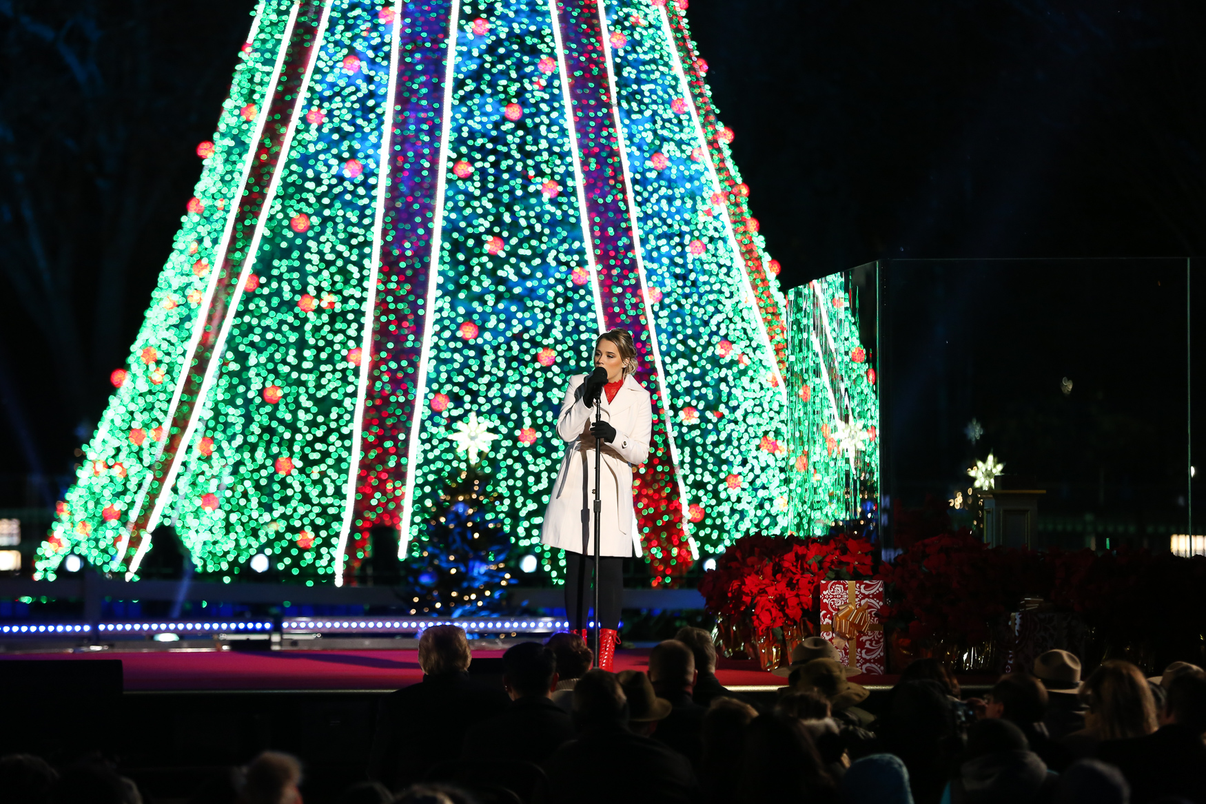 Despite frigid cold, the 2018 National Christmas Tree was illuminated by President Donald Trump and First Lady Melania Trump on November 28. The talent for the evening included some lesser-known acts, but they tried to rouse the holiday spirit with familiar Christmas carols. The festivities were hosted by Antonio Sabato Jr., a former model and soap opera store who supported President Trump during his 2016 campaign.{ } The celebration will be broadcast on{ }Ovation or REELZ on December 2 at 10 p.m. EST. (Amanda Andrade-Rhoades/DC Refined){ }