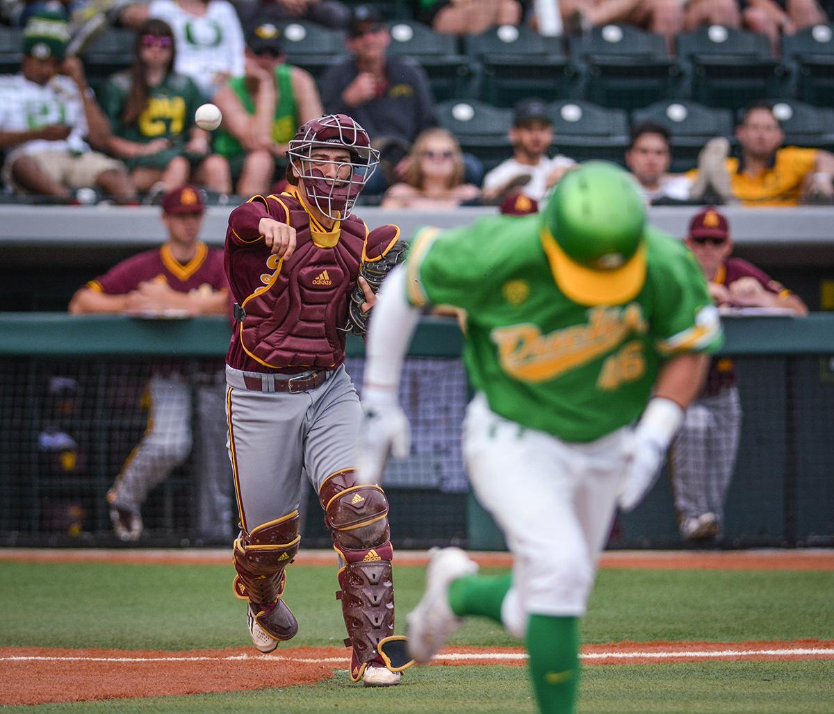 Sun Devils catcher Zach Cerbo (#30) throws the ball to first base to get the runner out. Despite a late comeback, the Ducks fall to Arizona State Sun Devils 4-3 in the second game of a three-game series. Photo by Jacob Smith, Oregon News Lab