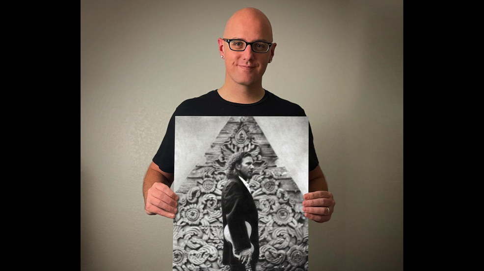 Artist Keegan Hall with the drawing he created of Eddie Vedder.png