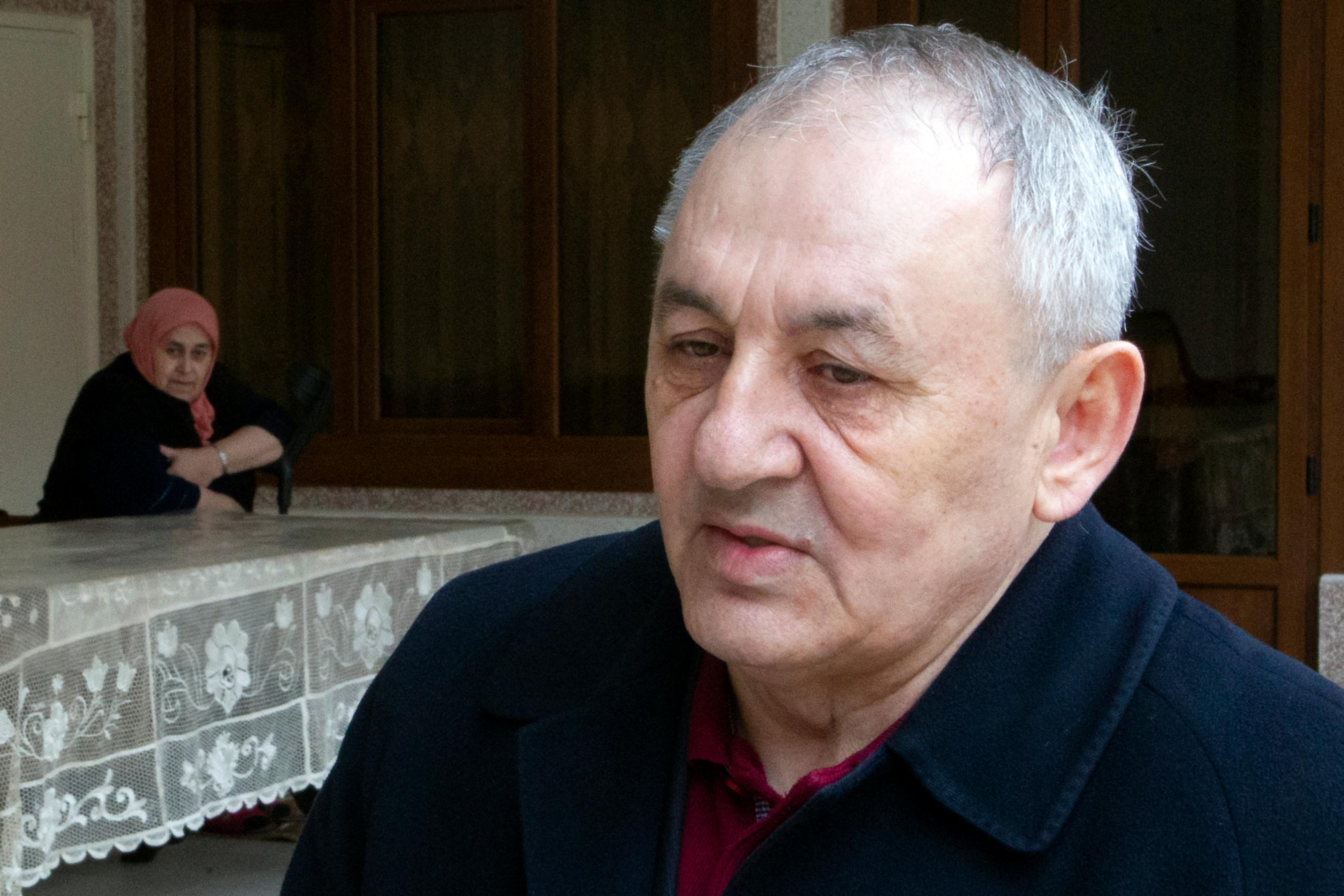 In this Sunday, March 17, 2019, photo, Yakub Titiyev, elder brother of jailed activist Oyub Titiyev, speaks to the Associated Press at their family home in Kurchaloy, Chechnya, Russia.{ } (AP Photo/Musa Sadulayev)