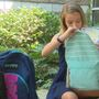 Middle schooler gives back one backpack at a time