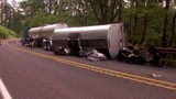 Hwy. 14 closed as rolled semi rig dumps liquid asphalt over roadway
