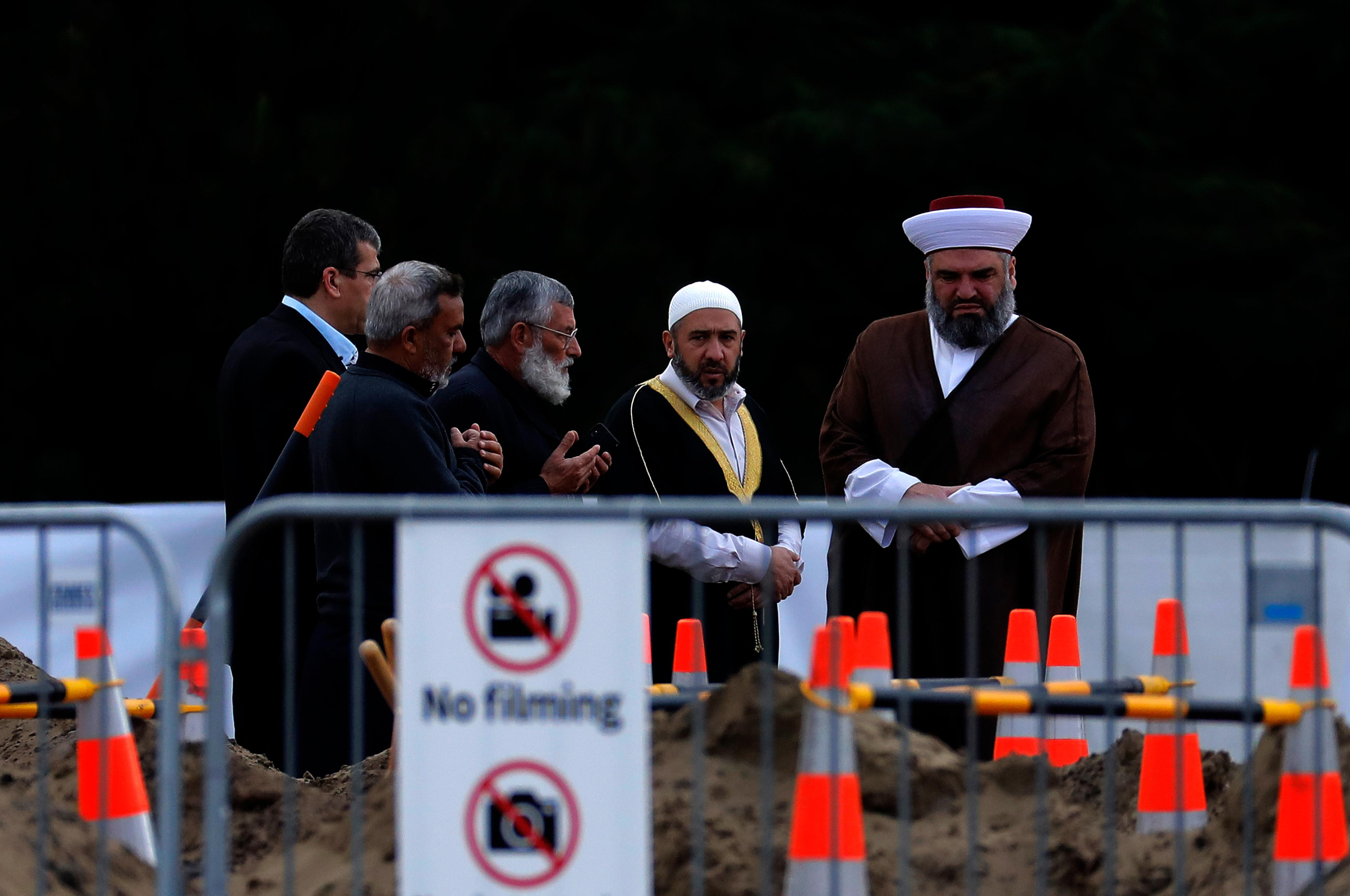 Mourners gather before a service of a victim from last week's mosque shooting for a burial at the Memorial Park Cemetery in Christchurch, New Zealand, Thursday, March 21, 2019. (AP Photo/Vincent Yu)