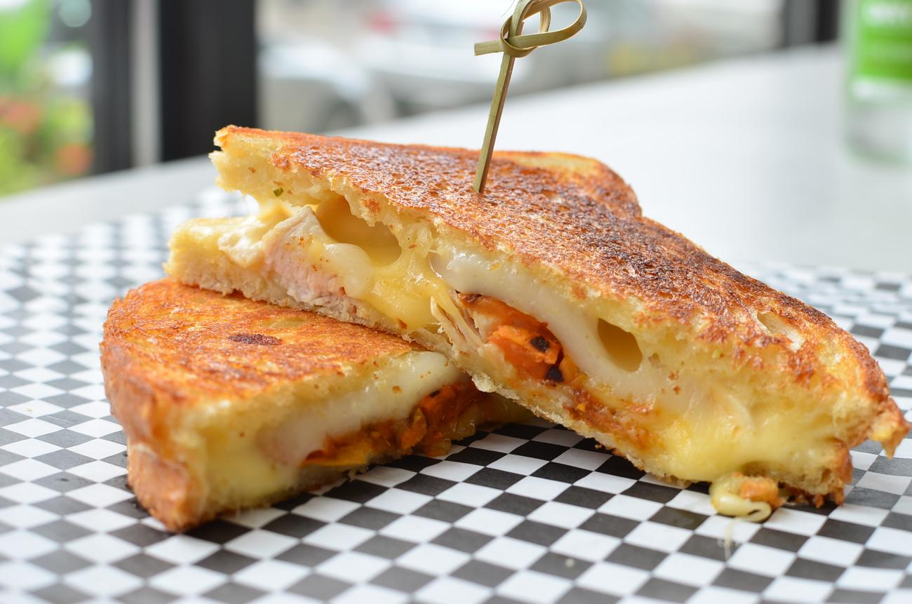Chicken Adobo Grilled Cheese - roasted chicken, adobo sauce, roasted sweet potato, drunken goat cheese, chihuahua cheese / Image: Leah Zipperstein, Cincinnati Refined // Published: 9.25.17