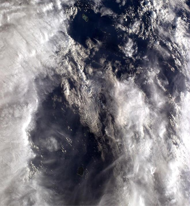 Clouds part for 2 beautiful atolls in Pacific.  (Photo & Caption courtesy Reid Wiseman (@Astro_Reid) and NASA)