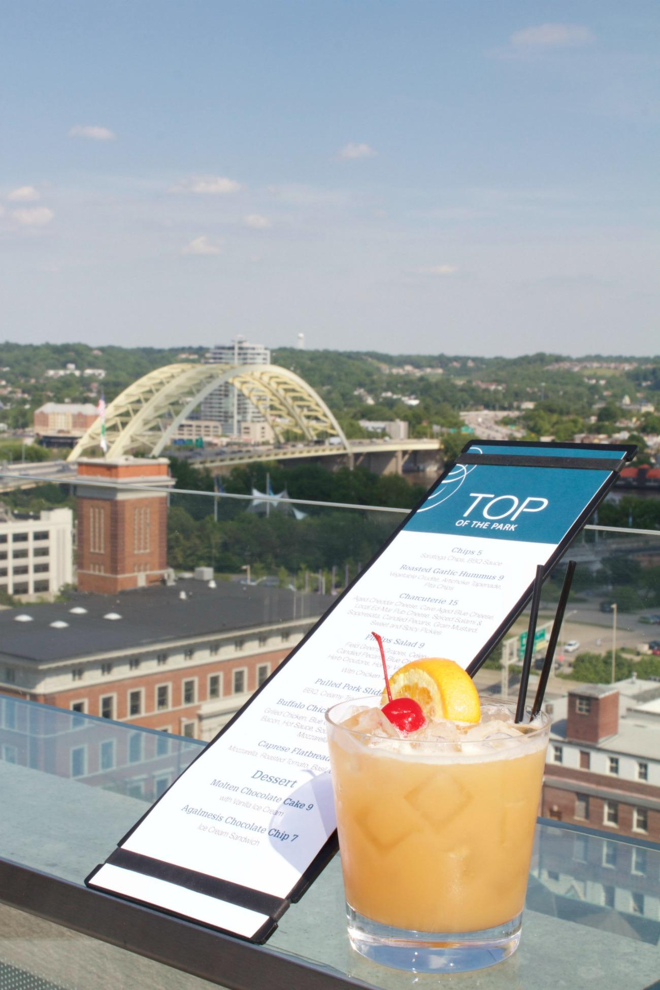 Top of the Park is located at 506 E 4th Street (45202). The bar is a haven for many YPs and business professionals seeking a unique happy hour experience featuring music and two levels of front-row seats to tremendous city views. / Image: Emily Cahill // Published: 6.7.17