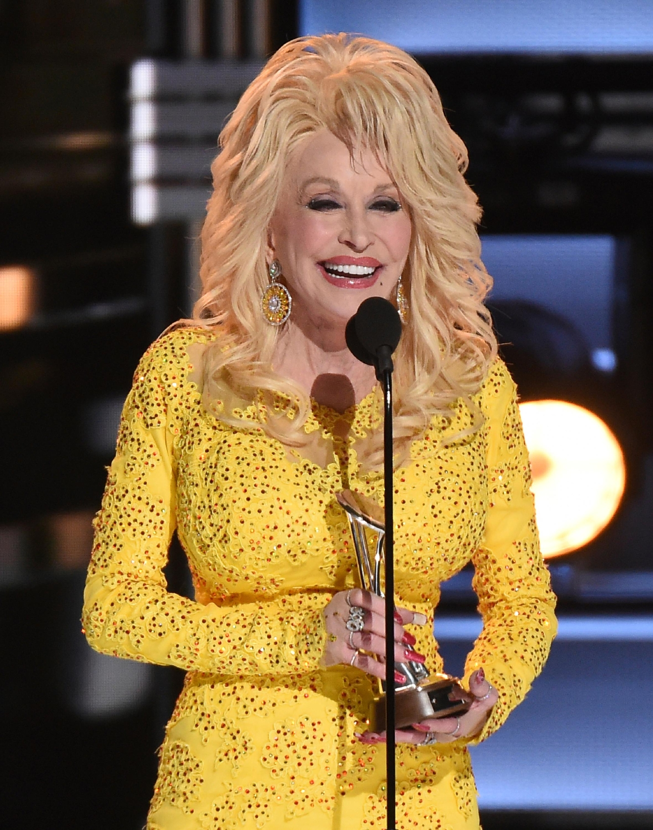 Dolly Parton accepts the Willie Nelson Lifetime Achievement Award at the 50th annual CMA Awards at the Bridgestone Arena on Wednesday, Nov. 2, 2016, in Nashville, Tenn. (Photo by Charles Sykes/Invision/AP)